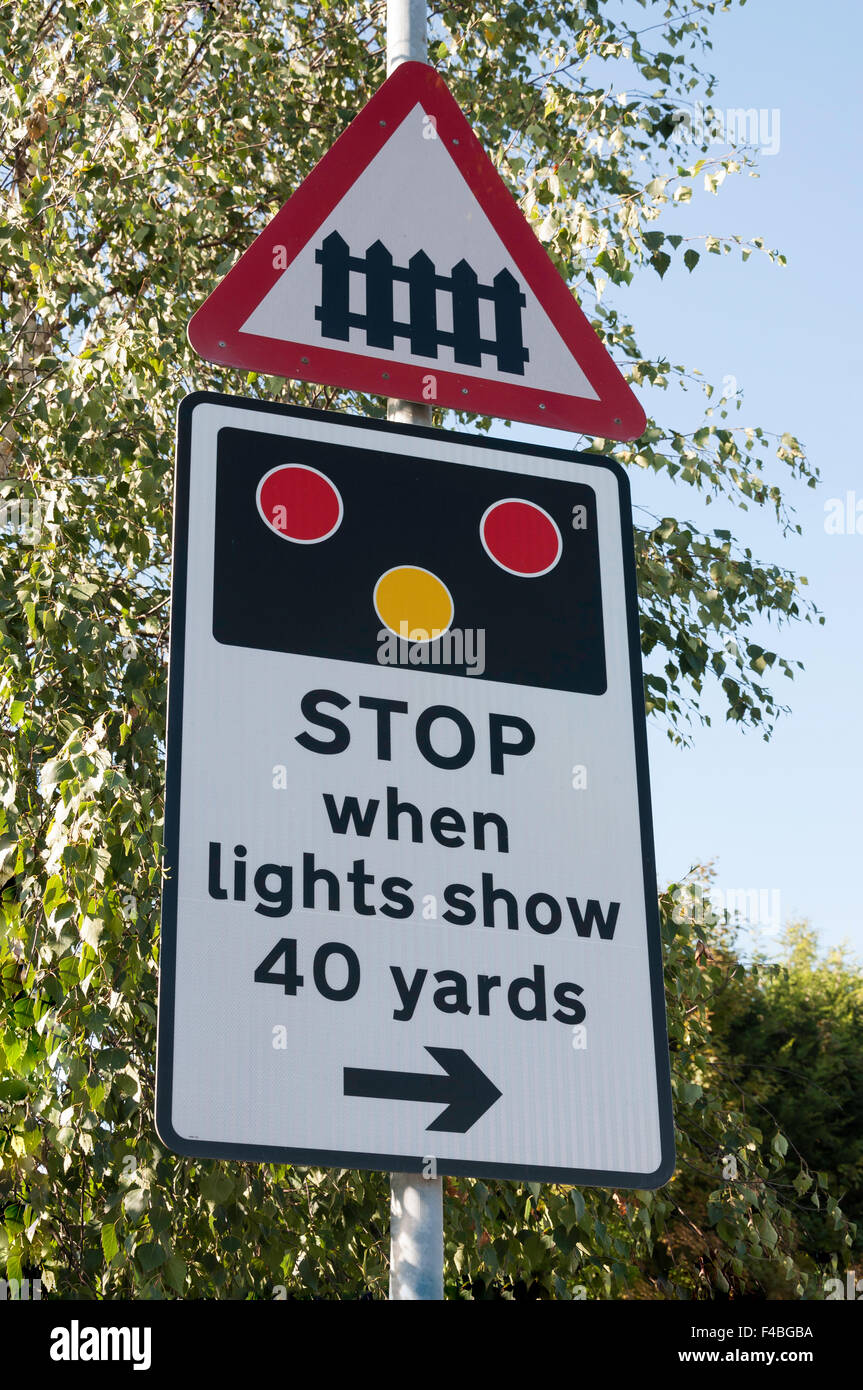 Railway crossing stop sign at Datchet Railway Station, Datchet, Berkshire, England, United Kingdom - Stock Image