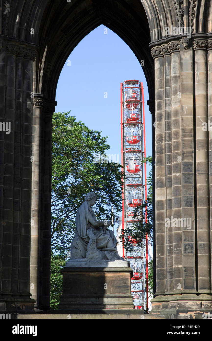 Princes Street Gardens Ferris Wheel as seen through the arch of The Scott Monument in Edinburgh, Scotland. - Stock Image