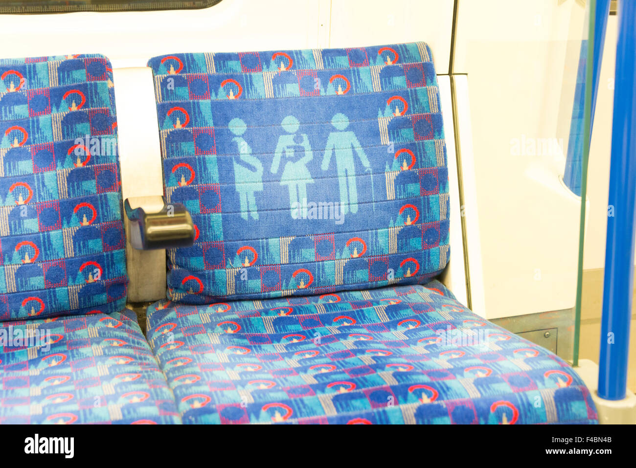 Seat for pregnant or elderly passengers on London Underground, Highgate, Greater London, England, United Kingdom - Stock Image
