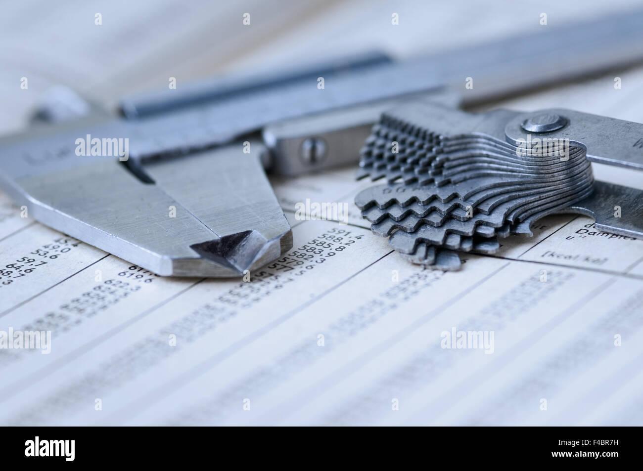vernier caliper and gauge on chart - Stock Image