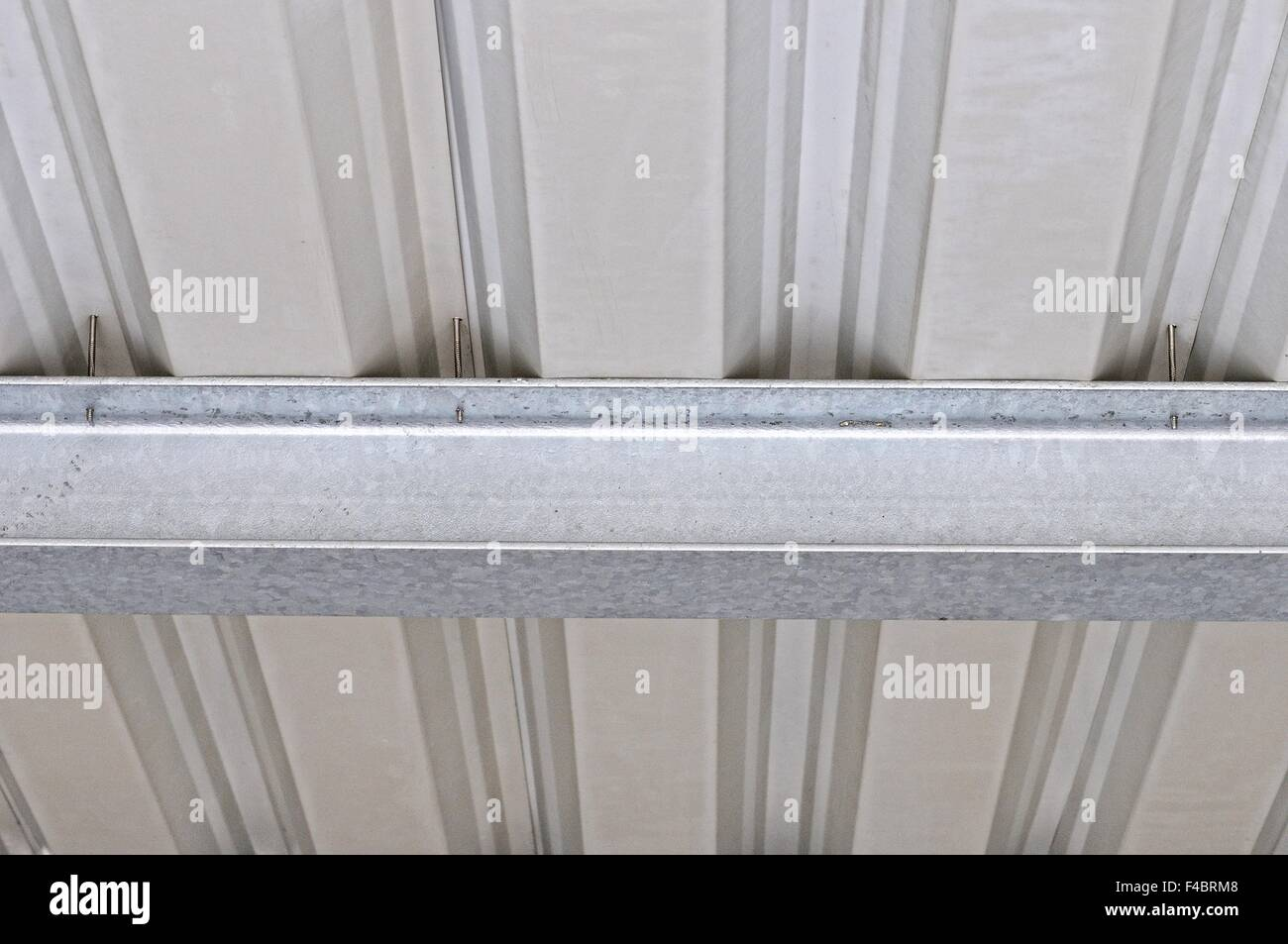 Shed roof attachment to steel beam - Stock Image