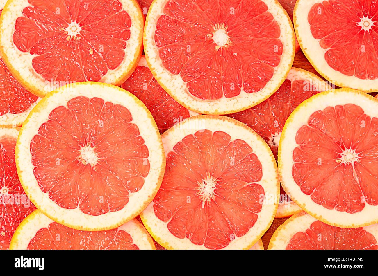 Fresh grapefruit as a background - Stock Image