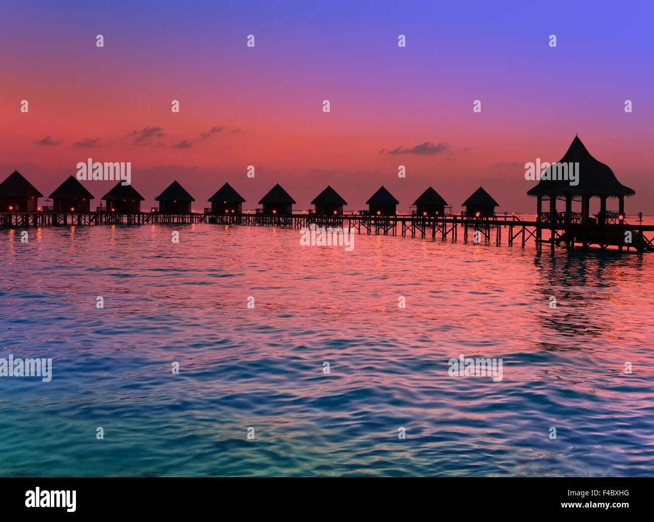 Island in ocean, Maldives.  Sunset. - Stock Image