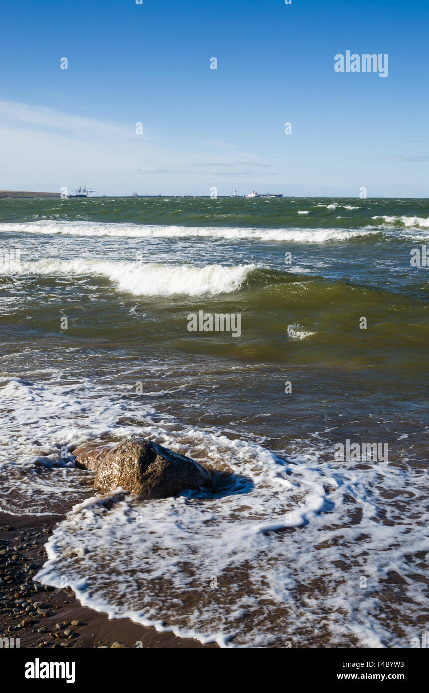Sea waves lapping on the shore. Baltic Sea. - Stock Image
