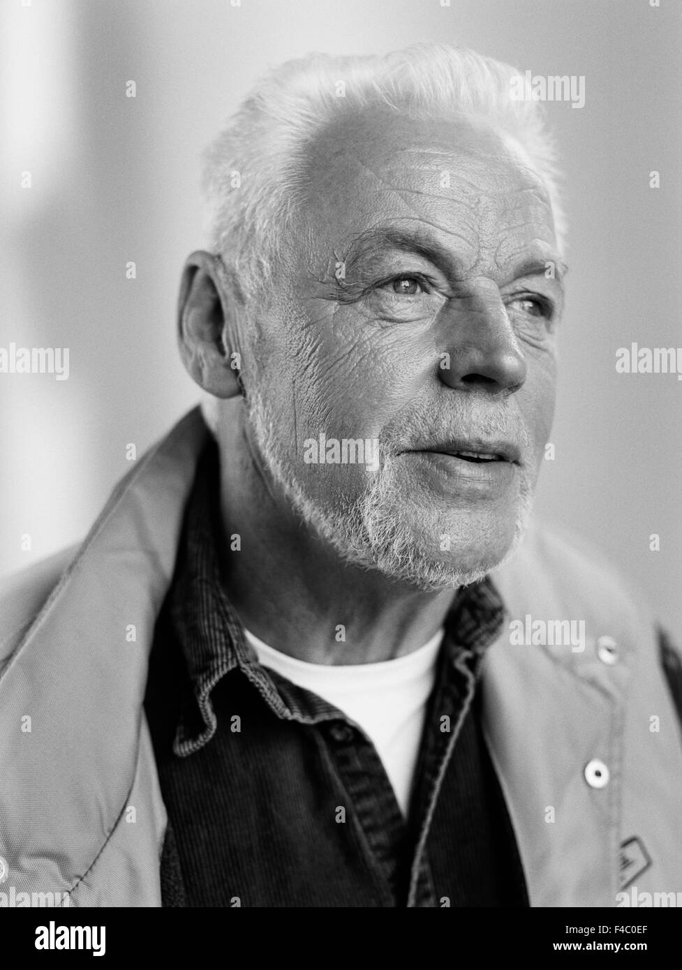 Old man in shirt and vest. - Stock Image