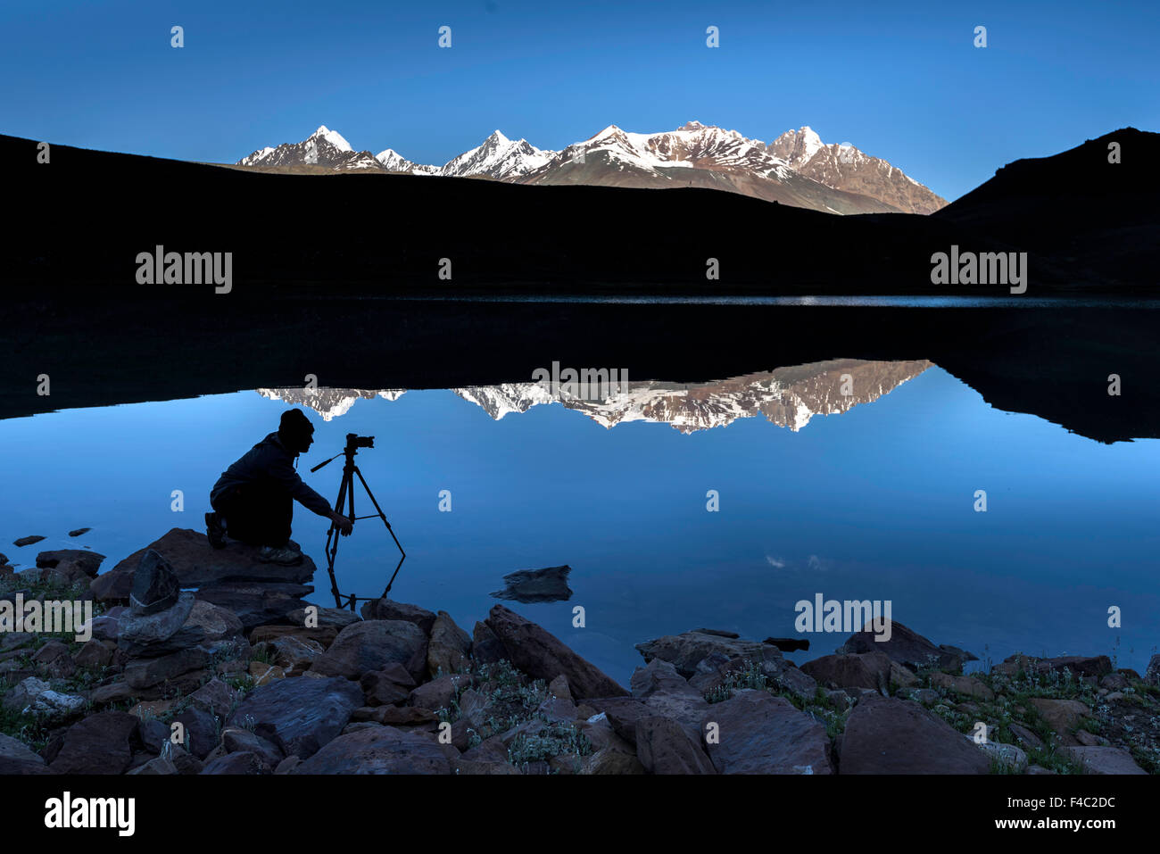 Early Morning Photographer is taking pictures at Chandratal Lake - Stock Image