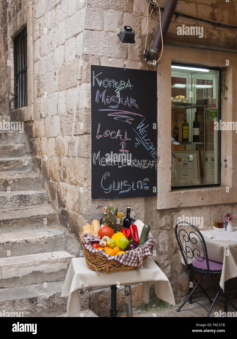 In the old town 'Stari Grad' of Dubrovnik Croatia there are lots of narrow streets with small inviting restaurants - Stock Image