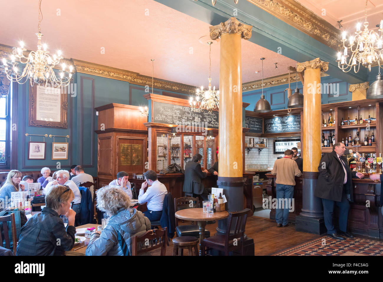 Interior of The Hung Drawn and Quartered Pub, Great Tower Street, City of London, London, England, United Kingdom - Stock Image