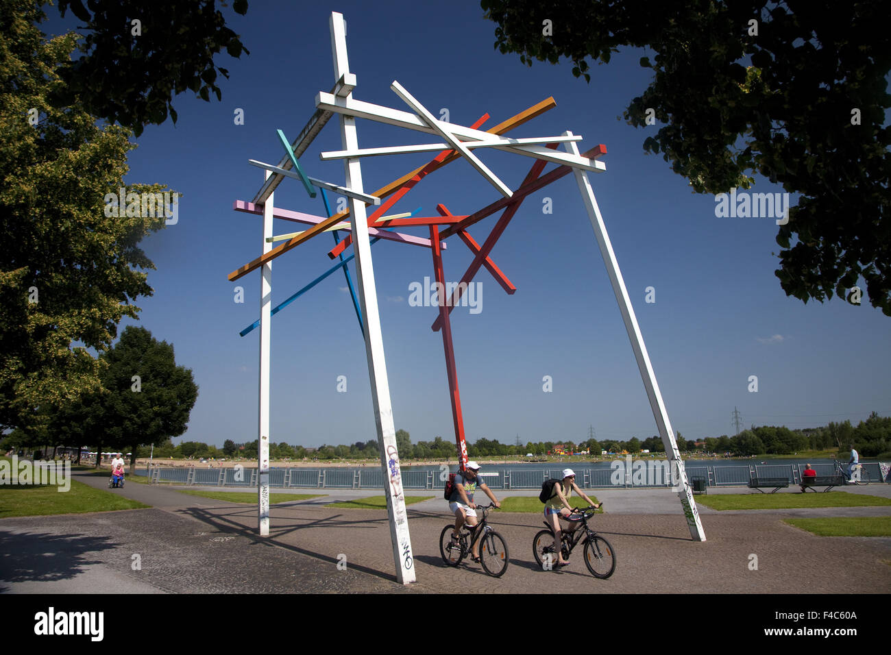 Two Cyclists at Sea Park Luenen, Germany - Stock Image