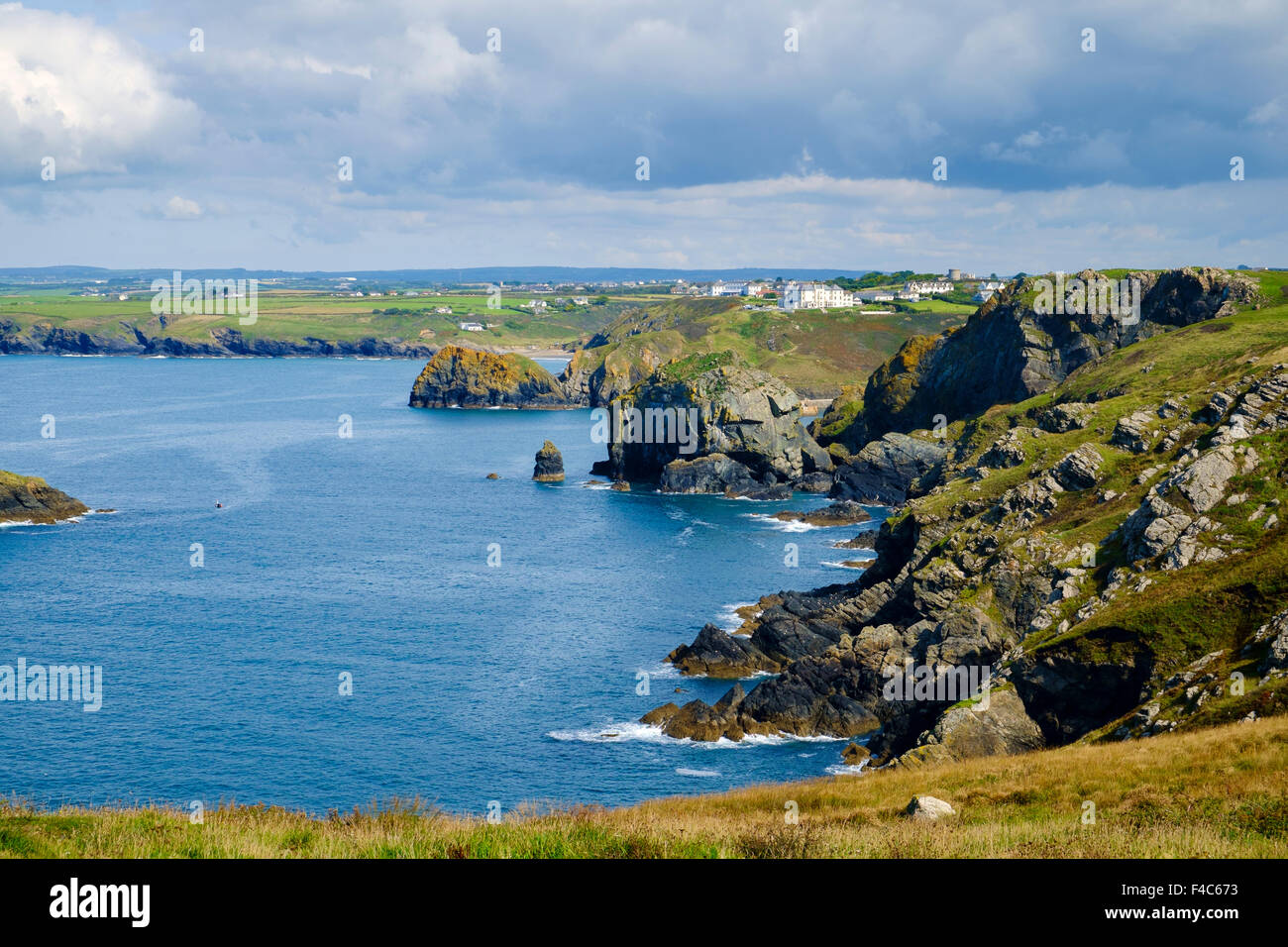 View of Cornish coast from South West Coast Path at Mullion, Lizard Peninsula, Cornwall, England, UK - Stock Image