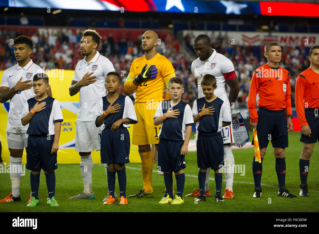 October 13, 2015: USA goalkeeper Tim Howard (12) and USA forward Jozy Altidore (17) stand during The National Anthem - Stock Image