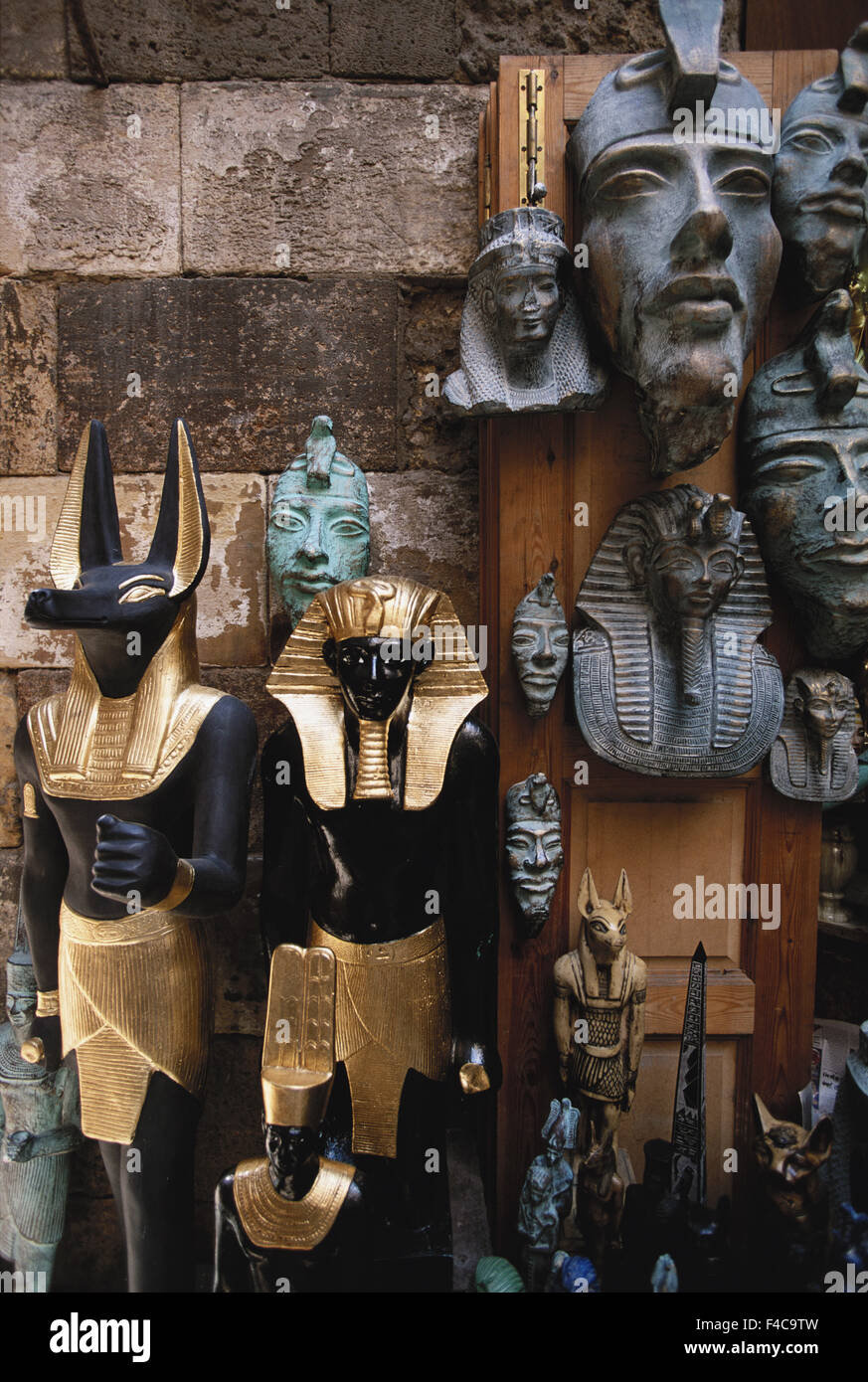 Egypt, Cairo, Statue and death mask in market. (Large format sizes available) - Stock Image