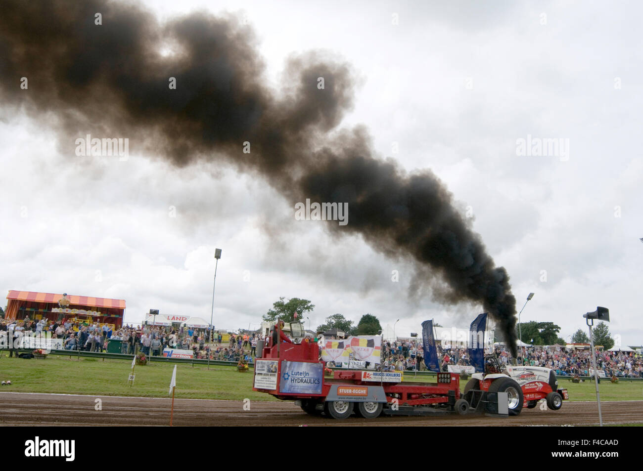 diesel emissions scandal thick black smoke over fueling vw volkswagen particulates particles unburnt smokey smoking - Stock Image