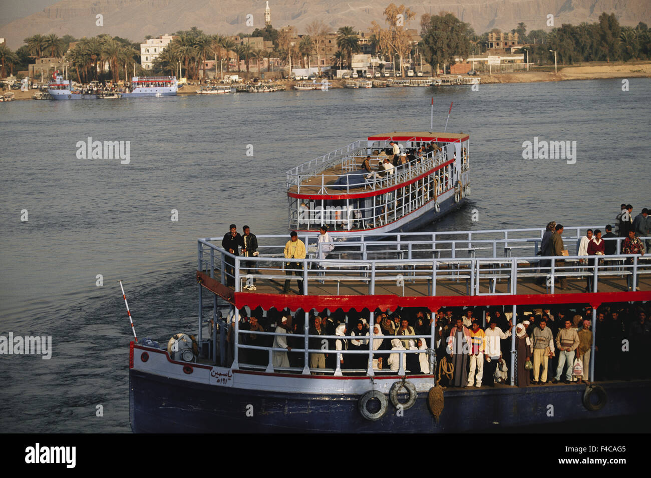 Egypt, Upper Egypt, Luxor, People in ferry boat at Nile River. (Large format sizes available) - Stock Image