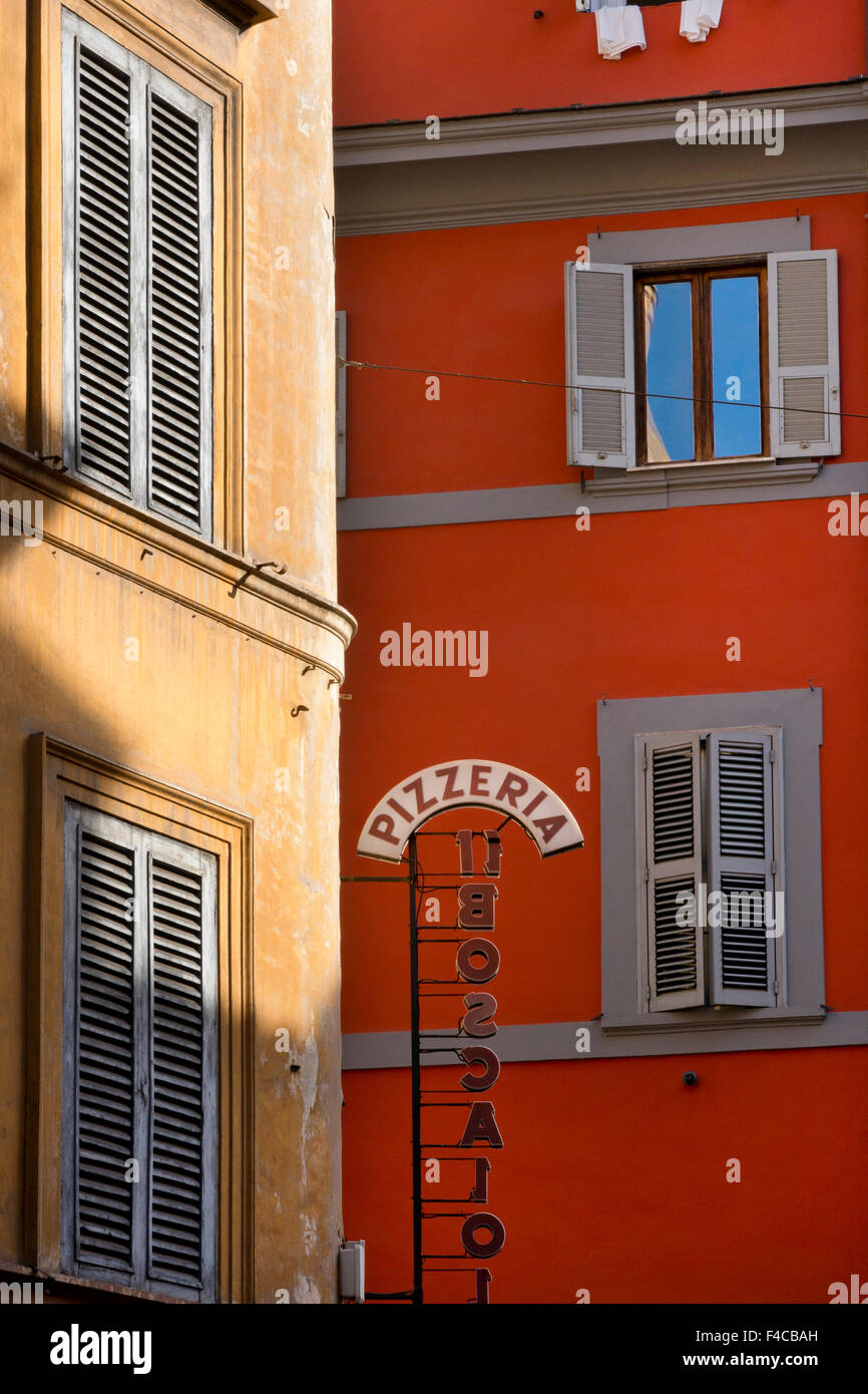 Pizzeria sign and typical architecture of Rome with ochre colored stonework and shutters,Rome,Italy,Europe - Stock Image