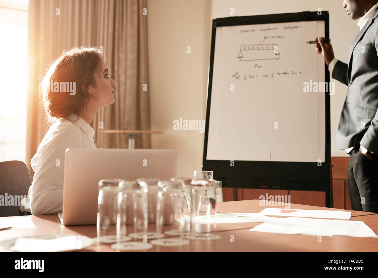 Portrait of an man sharing some of his thoughts on a flip board. Businessman explaining something to a colleague Stock Photo
