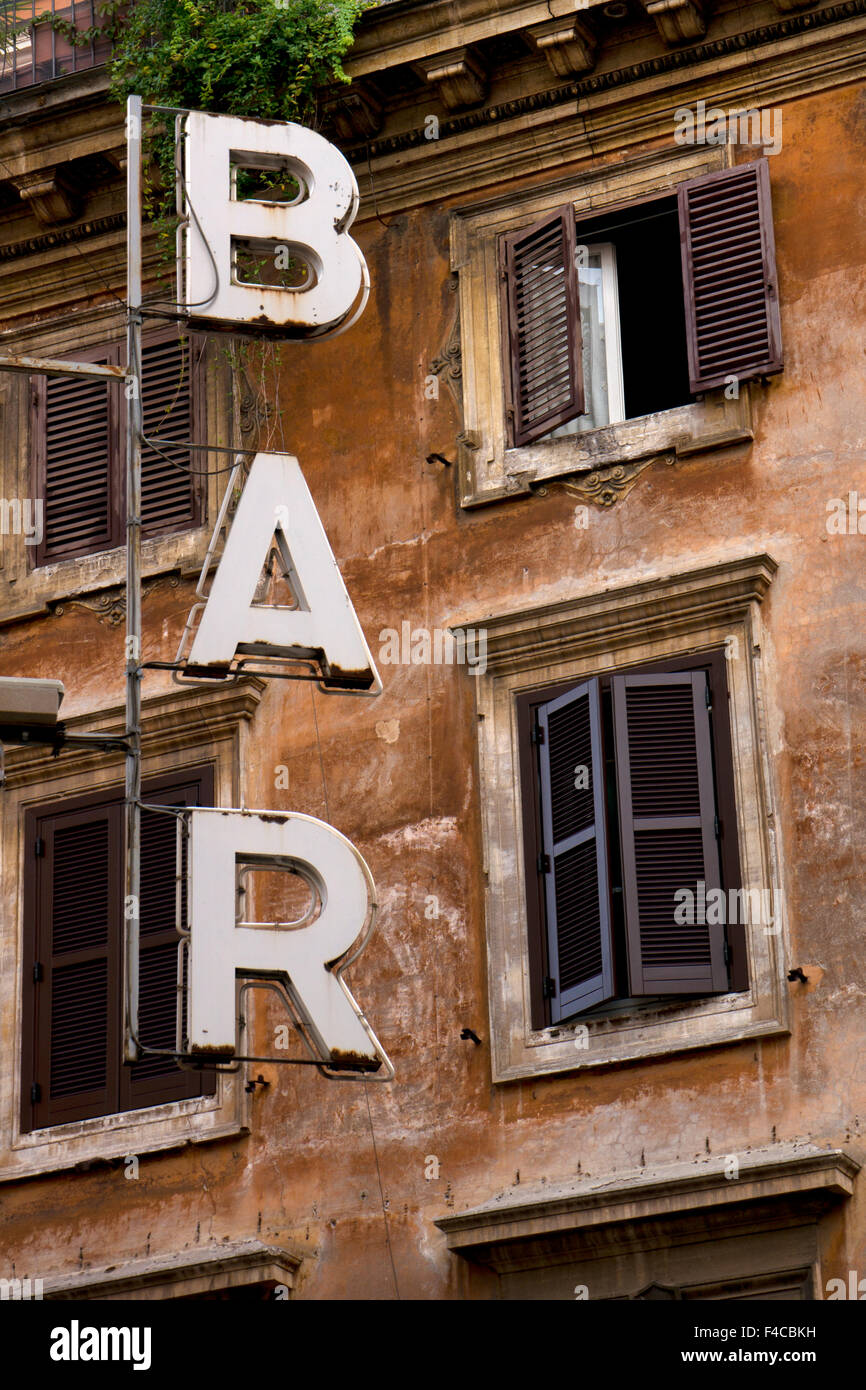 Bar sign and typical architecture of Rome with ochre colored stonework and shutters,Rome,Italy,Europe - Stock Image