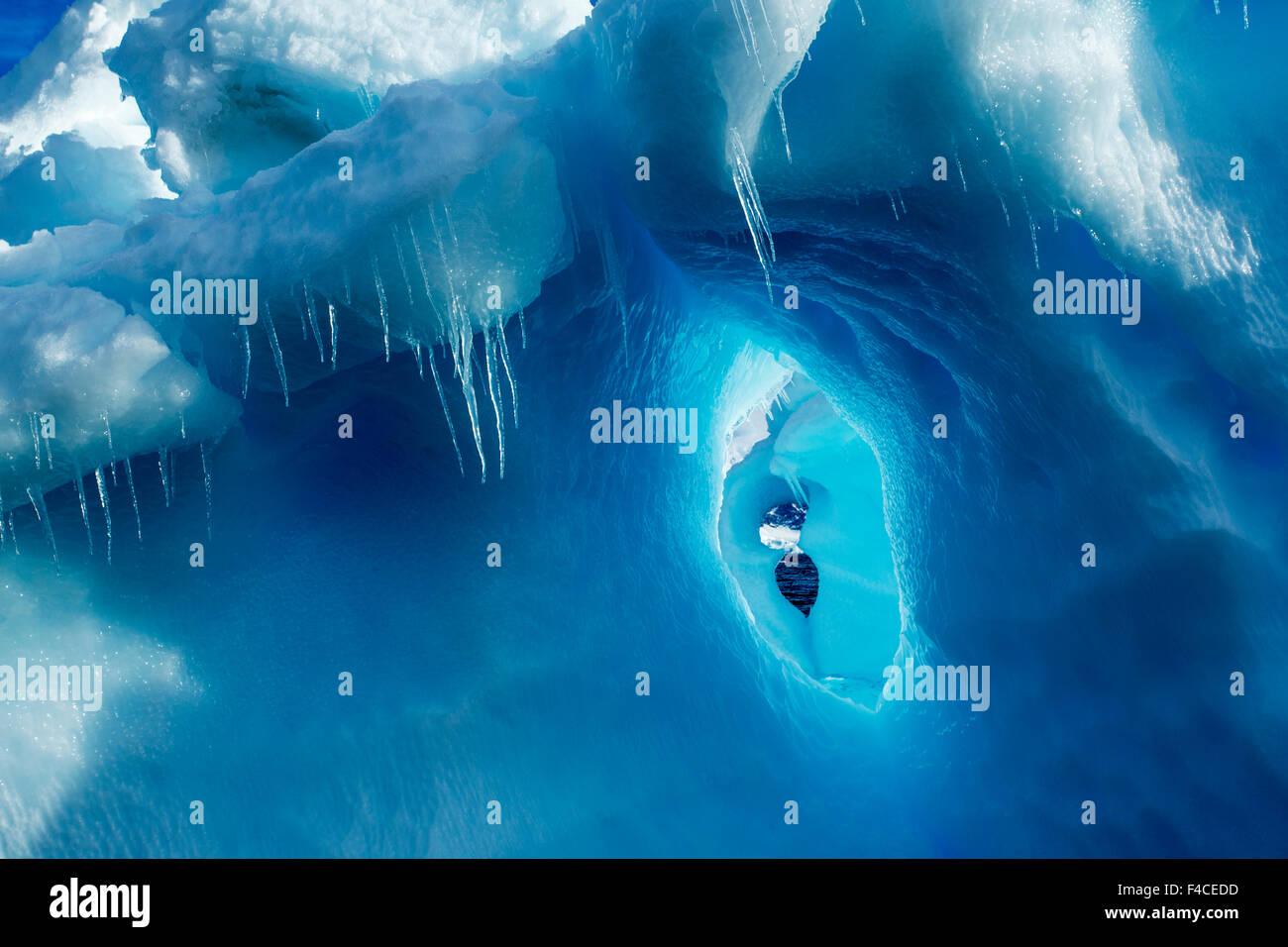 Antarctica, Icicles hang from iceberg near Enterprise Island in Wilhelmina Bay along Antarctic Peninsula. Stock Photo