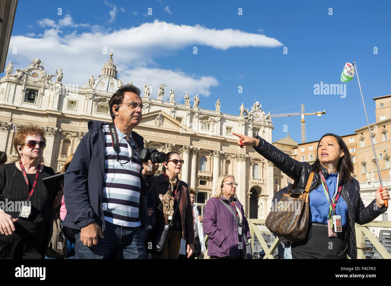 Sightseeing group and tour leader at St. Peter's square, Vatican city, Rome, Italy - Stock Image