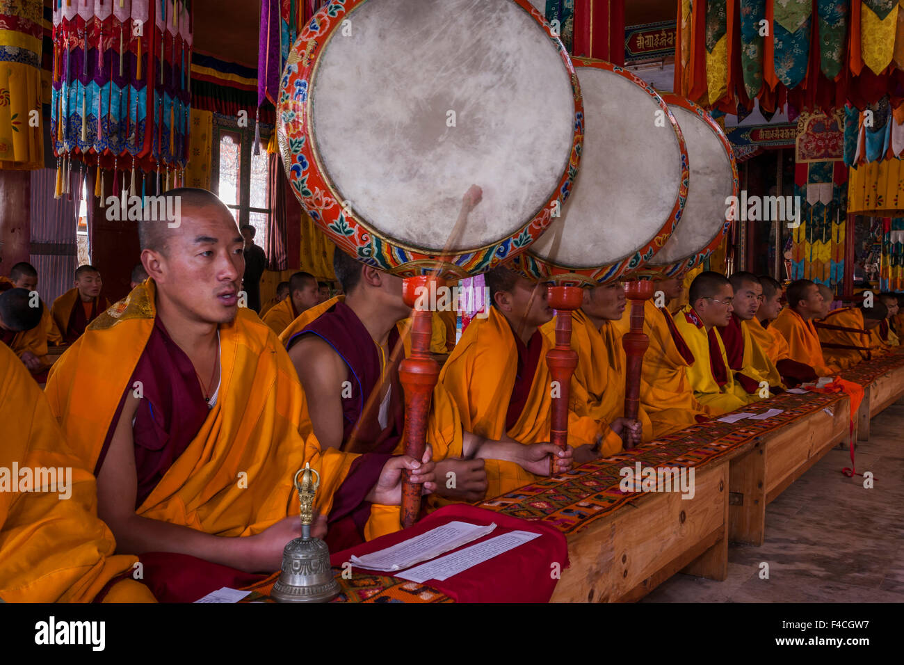 Bhutan, Jakar, Monks chanting and playing drums - Stock Image