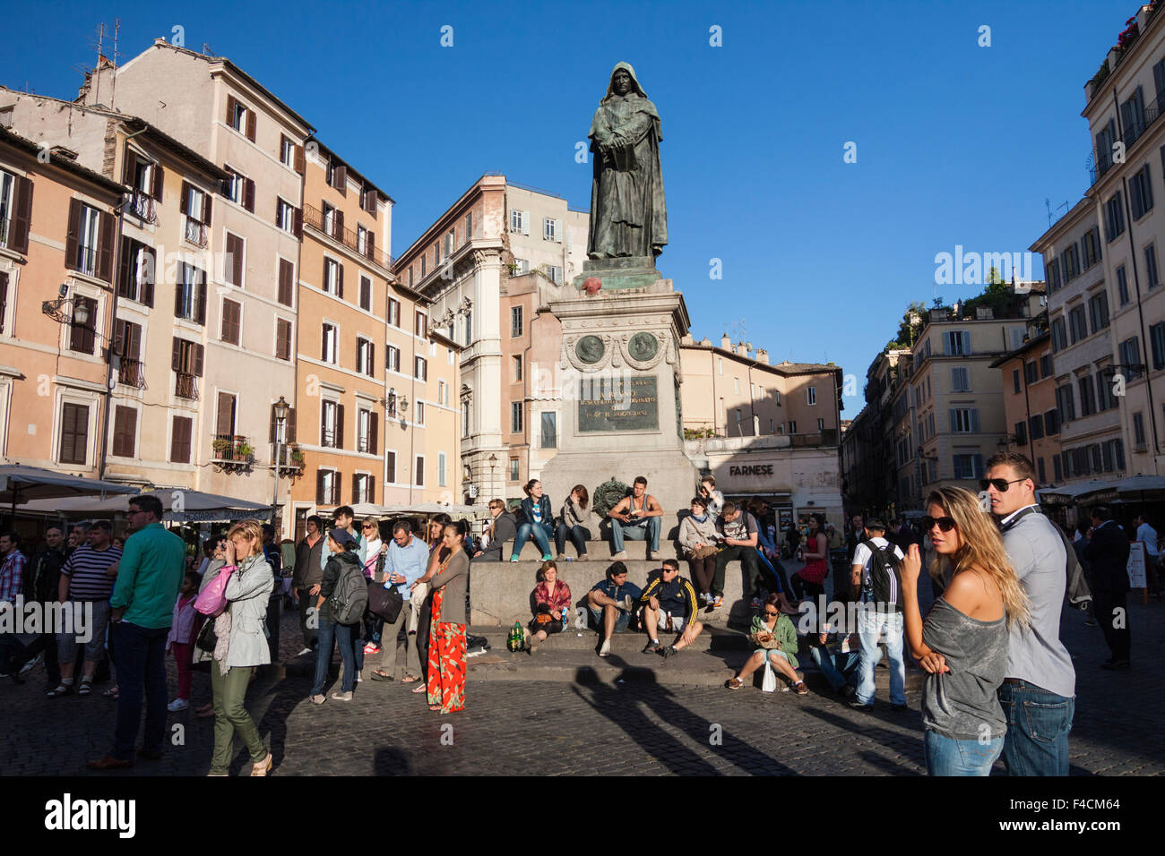 People next to the Giordano Bruno statue at Campo de Fiori square, Rome, Italy - Stock Image