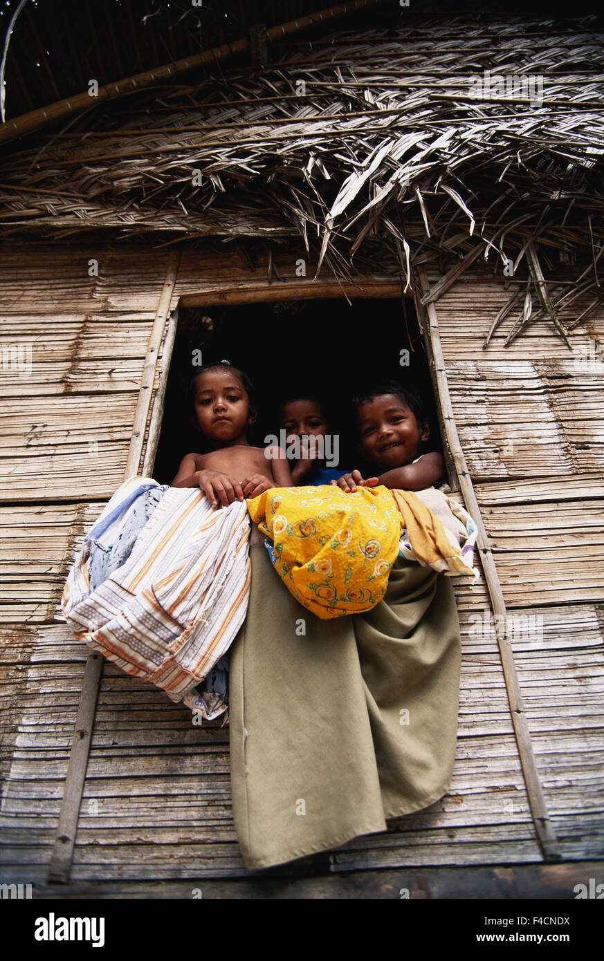 Malaysia, Cameron highlands, Orang Asli, Children looking through window of house. (Large format sizes available) - Stock Image