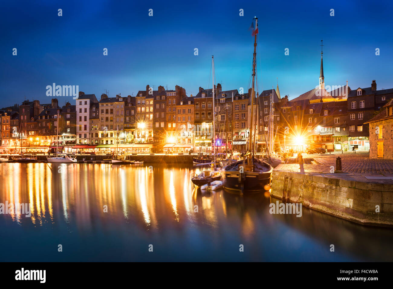 Nightscape of the old harbor in Honfleur, France (02) - Stock Image