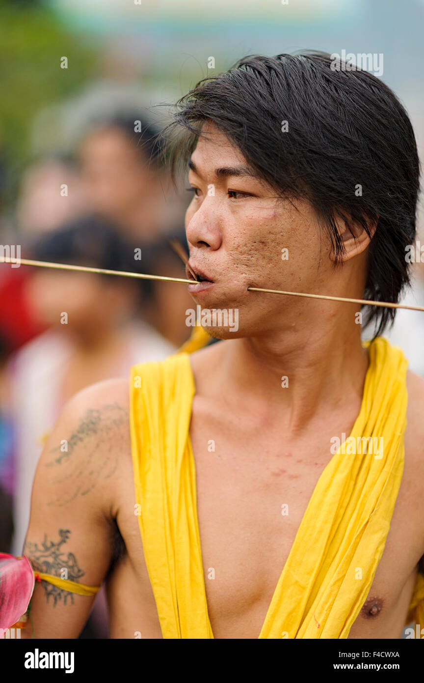 West Kalimantan, Indonesia-February 24, 2013 : The shaman Sticking steels wire into his cheeks. An Extra ordinary - Stock Image