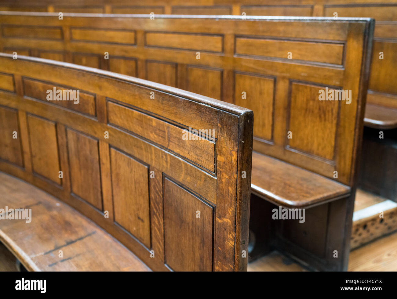 Old wooden courtroom seating in St George's hall, Liverpool. - Stock Image