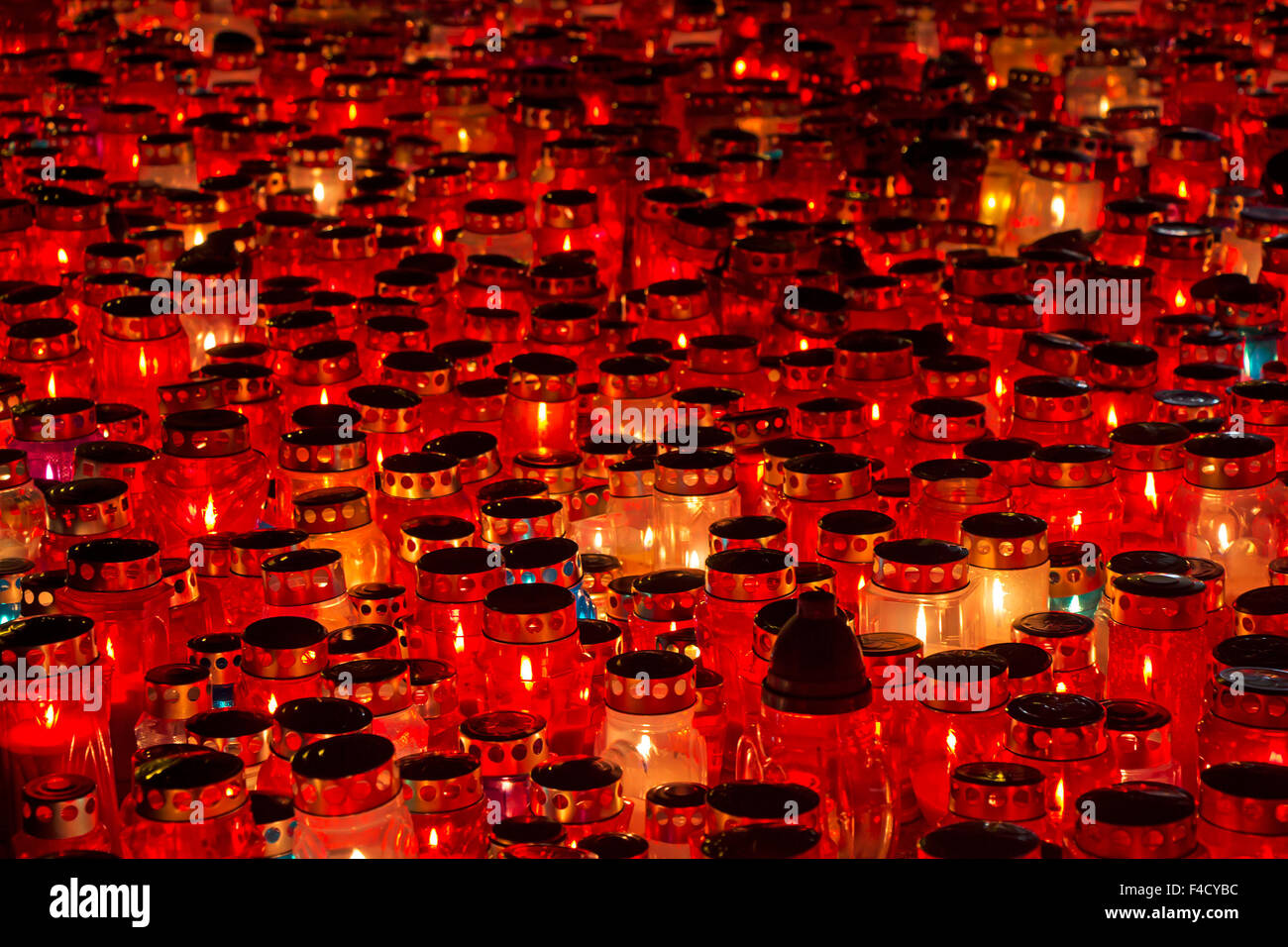 A lot of Candles Burning At a Cemetery During All Saints Day - Stock Image