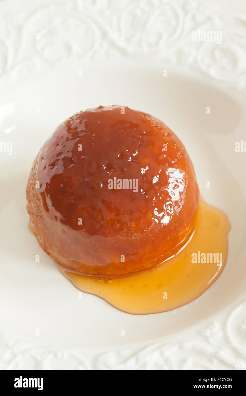 Steamed golden syrup sponge pudding - Stock Image