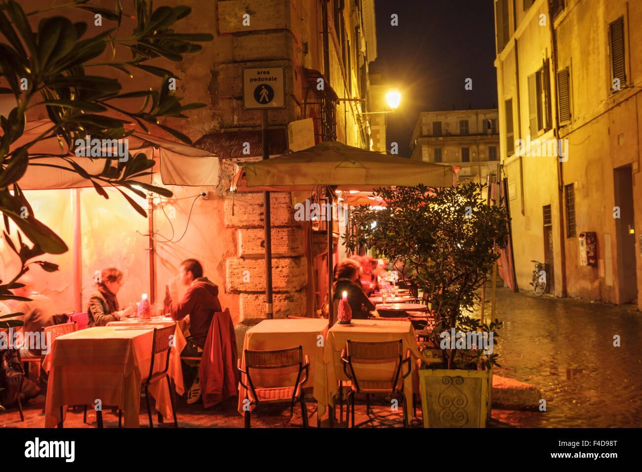 Alfresco dining at night inTrastevere, Rome, Italy - Stock Image
