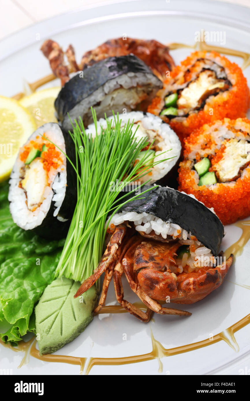 spider roll, maki sushi made of soft shell crab tempura and sushi rice, halloween party dinner - Stock Image