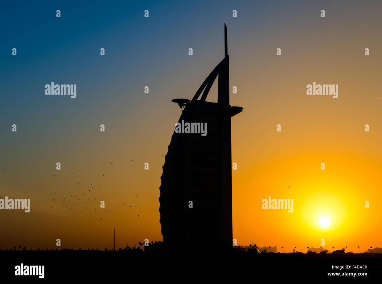 Silhouette of Hotel Burj Al Arab, Dubai, in sunset - Stock Image