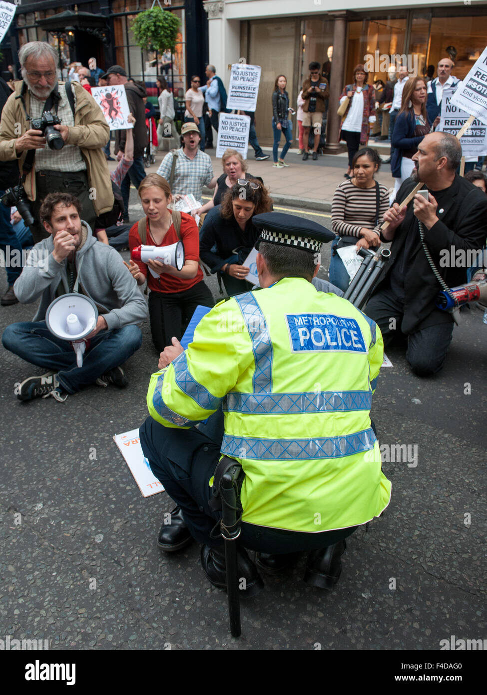 Activists gather outside Sotheby's on London's New Bond Street to protest against the alleged banning of - Stock Image