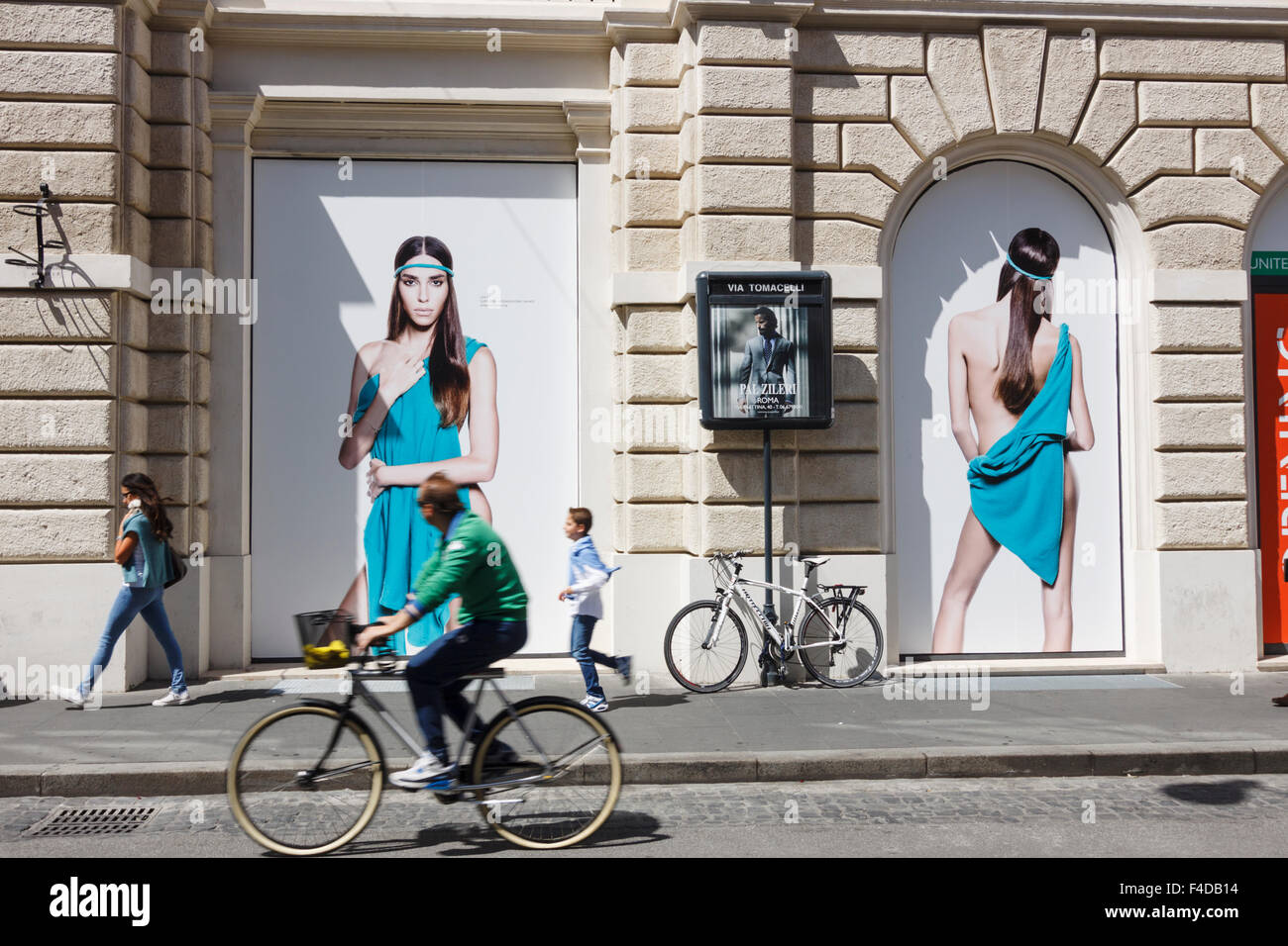 People walks past Benetton store at Via Tomacelli, Rome, Italy - Stock Image