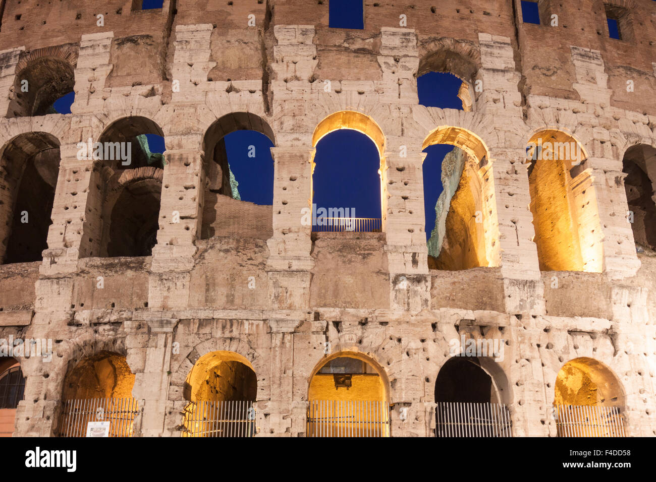 Detail of illuminated arches of the Coliseum at dusk. Rome, Italy - Stock Image