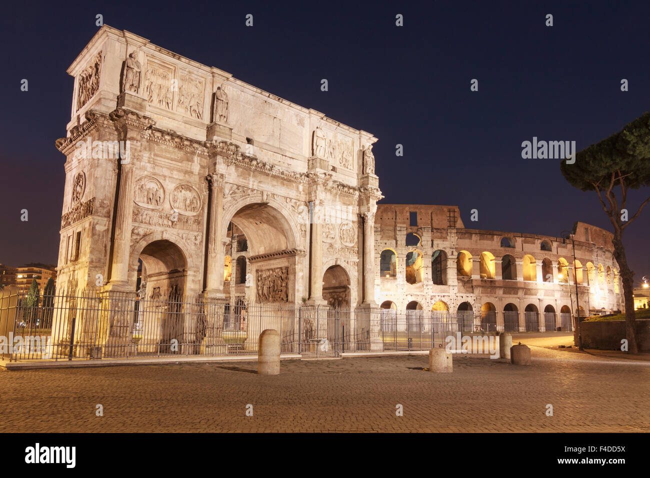 Arch of Constantine and Coliseum illuminated by night. Rome, Italy - Stock Image