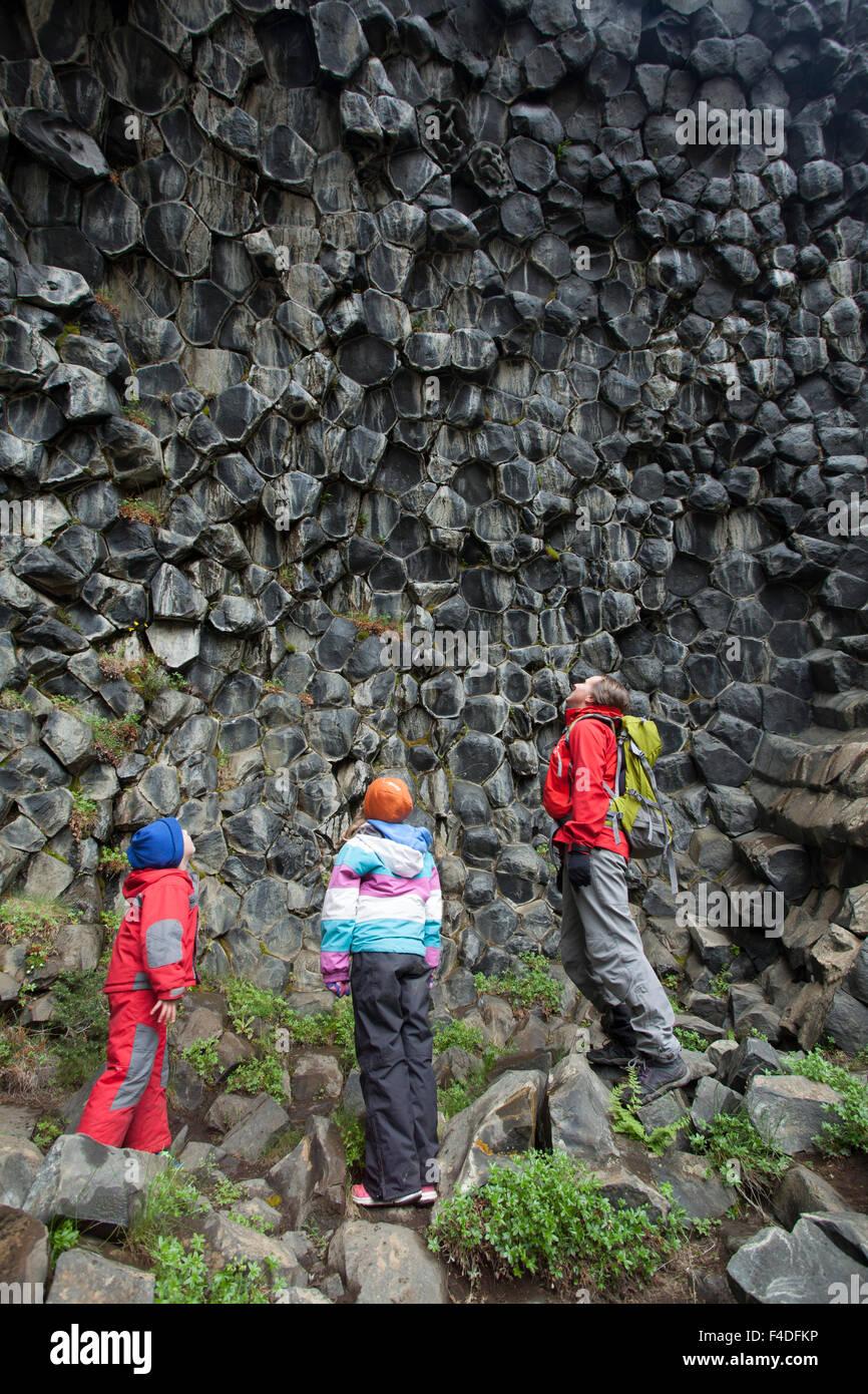 Family studying basalt rock formations at Hljodaklettar, Jokulsargljufur, Nordhurland Eystra, Iceland. - Stock Image