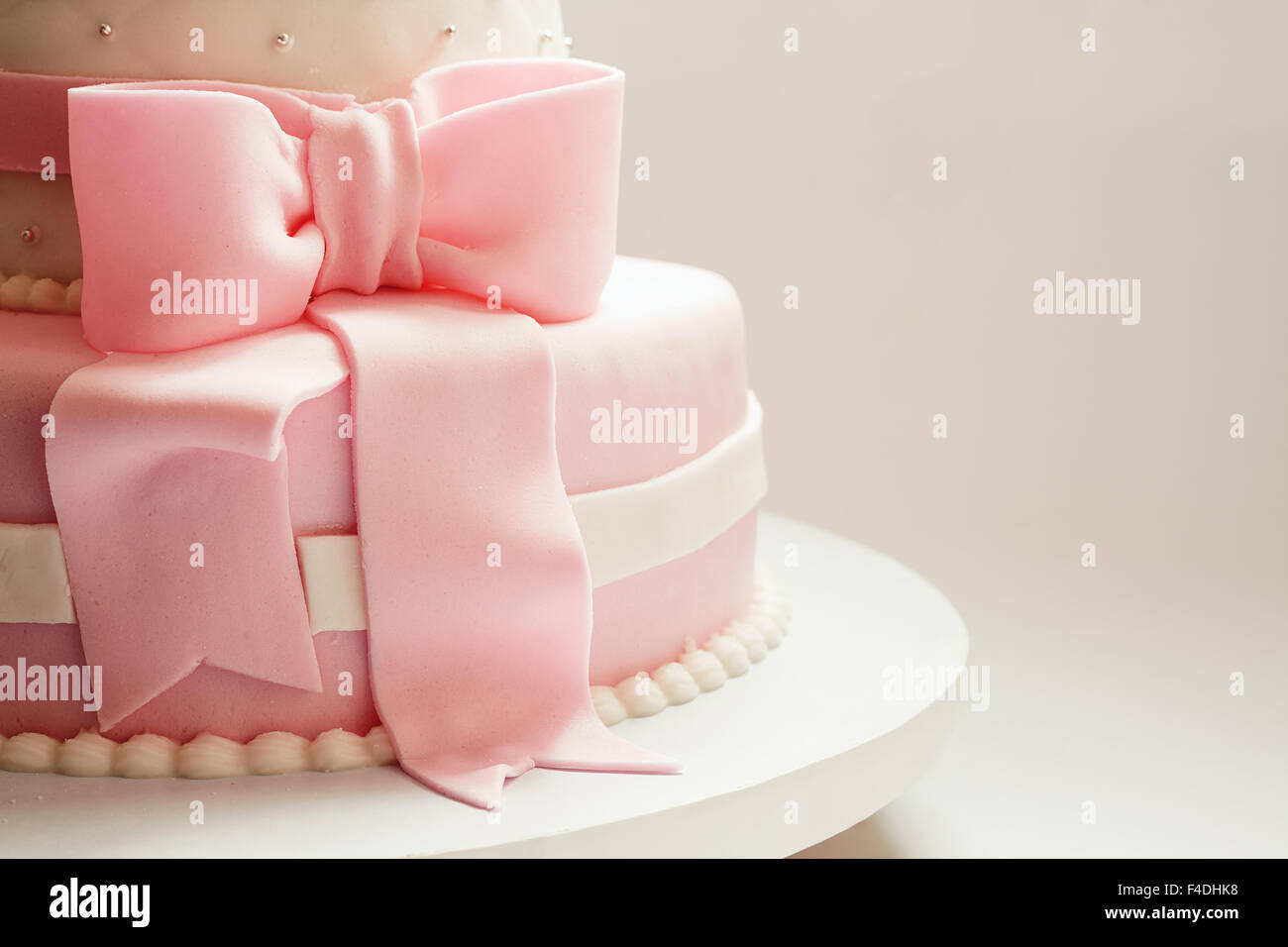 Ribbon details on a birthday cake made for baby girl. - Stock Image