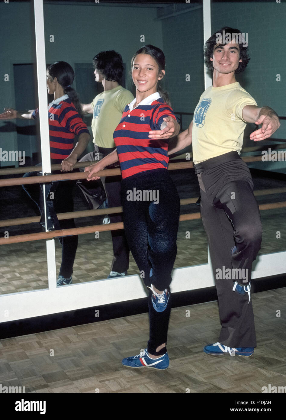 American teenagers Tai Babilonia, 18, and Randy Gardner, 19, exercise before practicing their pair ice skating routines - Stock Image