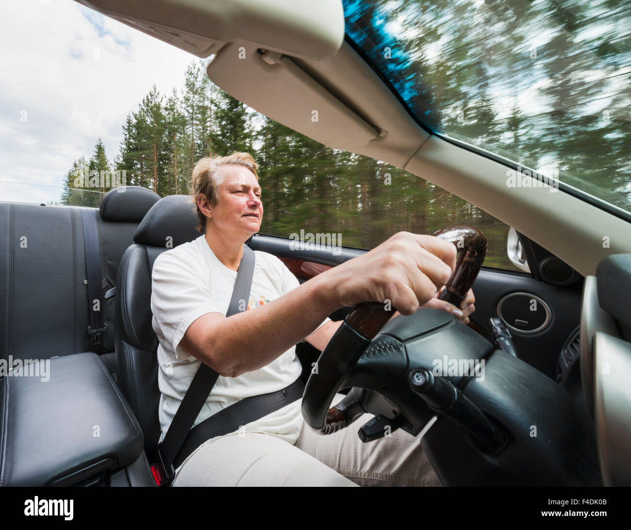 Woman driving a convertible - Stock Image