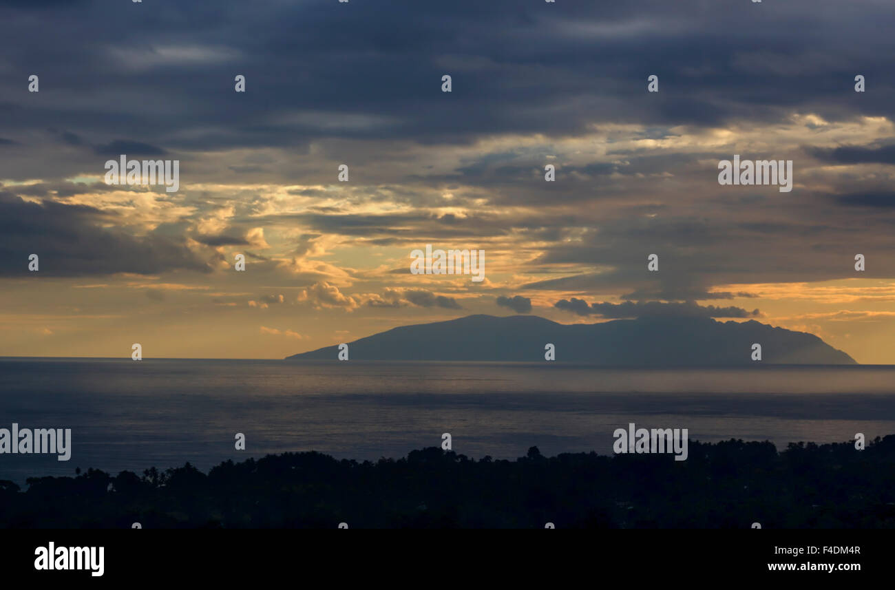 The sunset as viewed from Dili, capital of East Timor - Stock Image