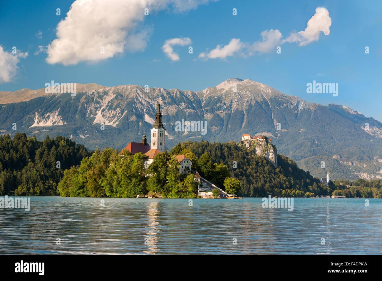 Island at Lake Bled at a sunny day, Slovenia - Stock Image