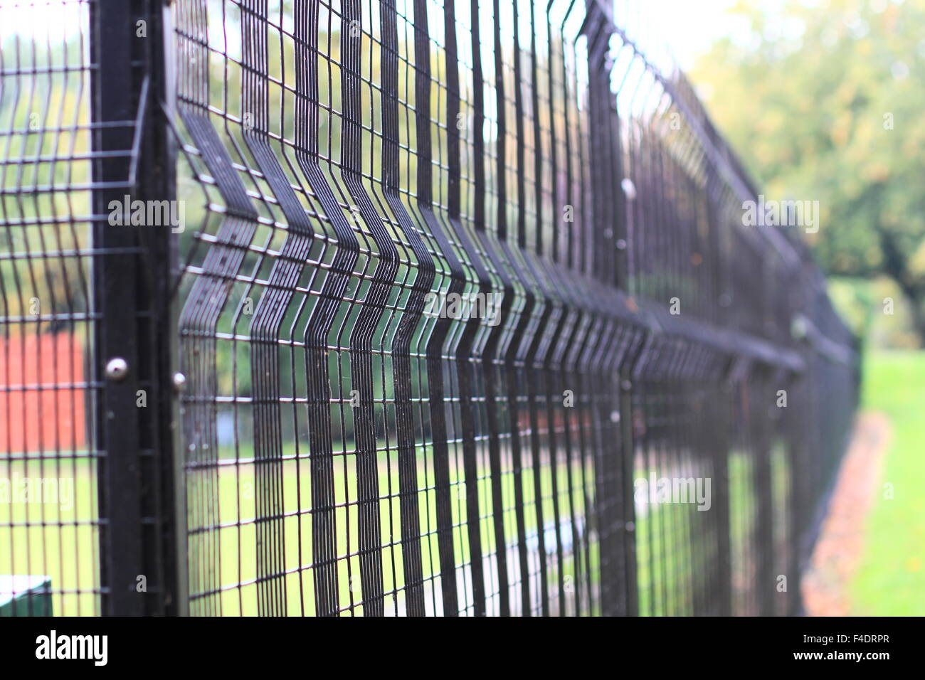 black wire fence - Stock Image