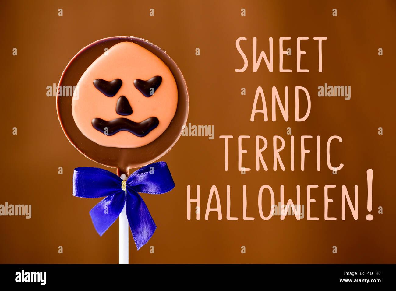 Halloween character message sign pumpkin stock photos halloween a pumpkin shaped chocolate lollipop and the text sweet and terrific halloween against a brown m4hsunfo
