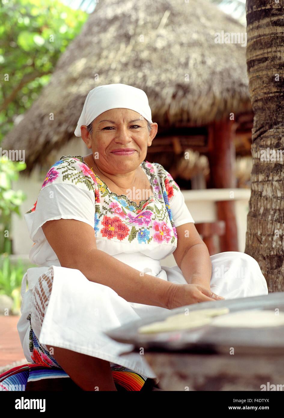 A Mexican woman makes tortillas by the beach at Maroma Spa and Resort.Riviera Maya,Yucatan,Mexico, - Stock Image