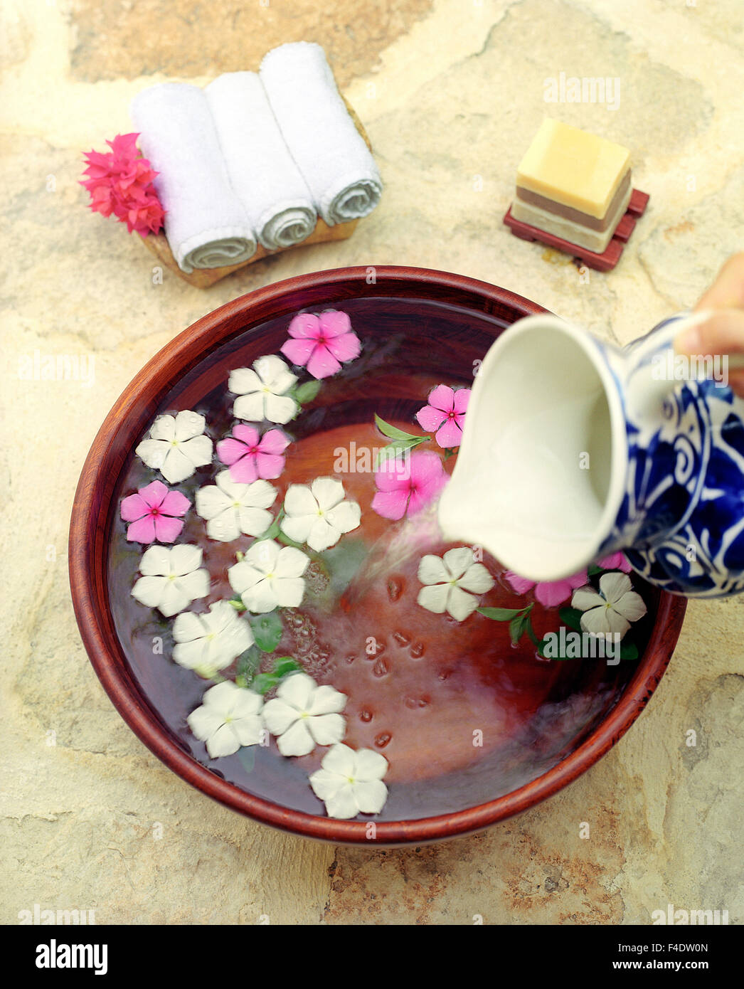 A foot wash with Mexican myrtle flowers  and orange blossom, chocolate truffle, mint soaps. Riviera Maya,Yucatan,Mexico - Stock Image