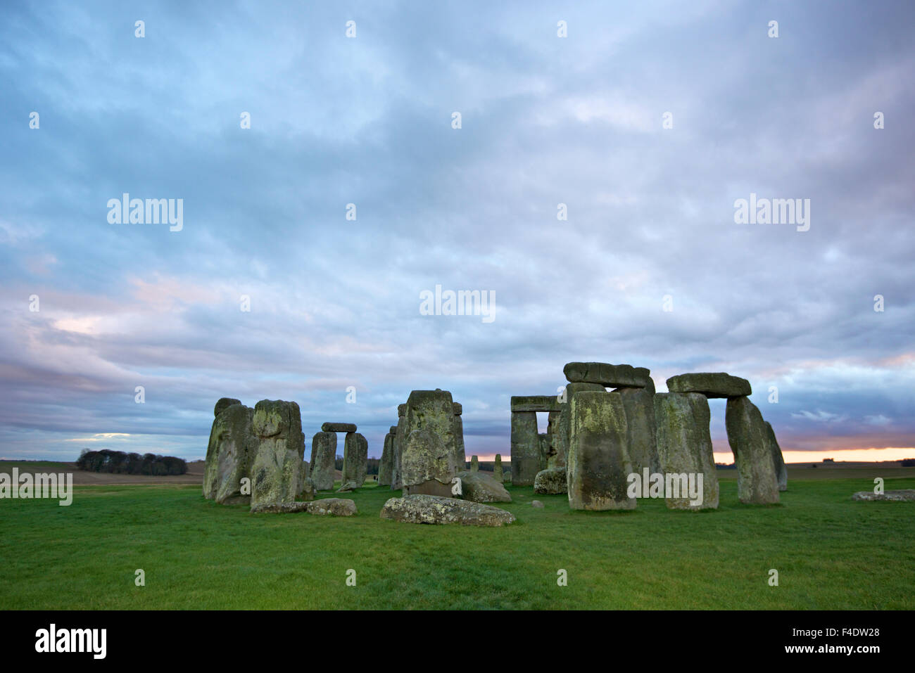 The Neolithic monument Stonehenge beneath a winter sky, just days from the solstice. It is visited by thousands - Stock Image
