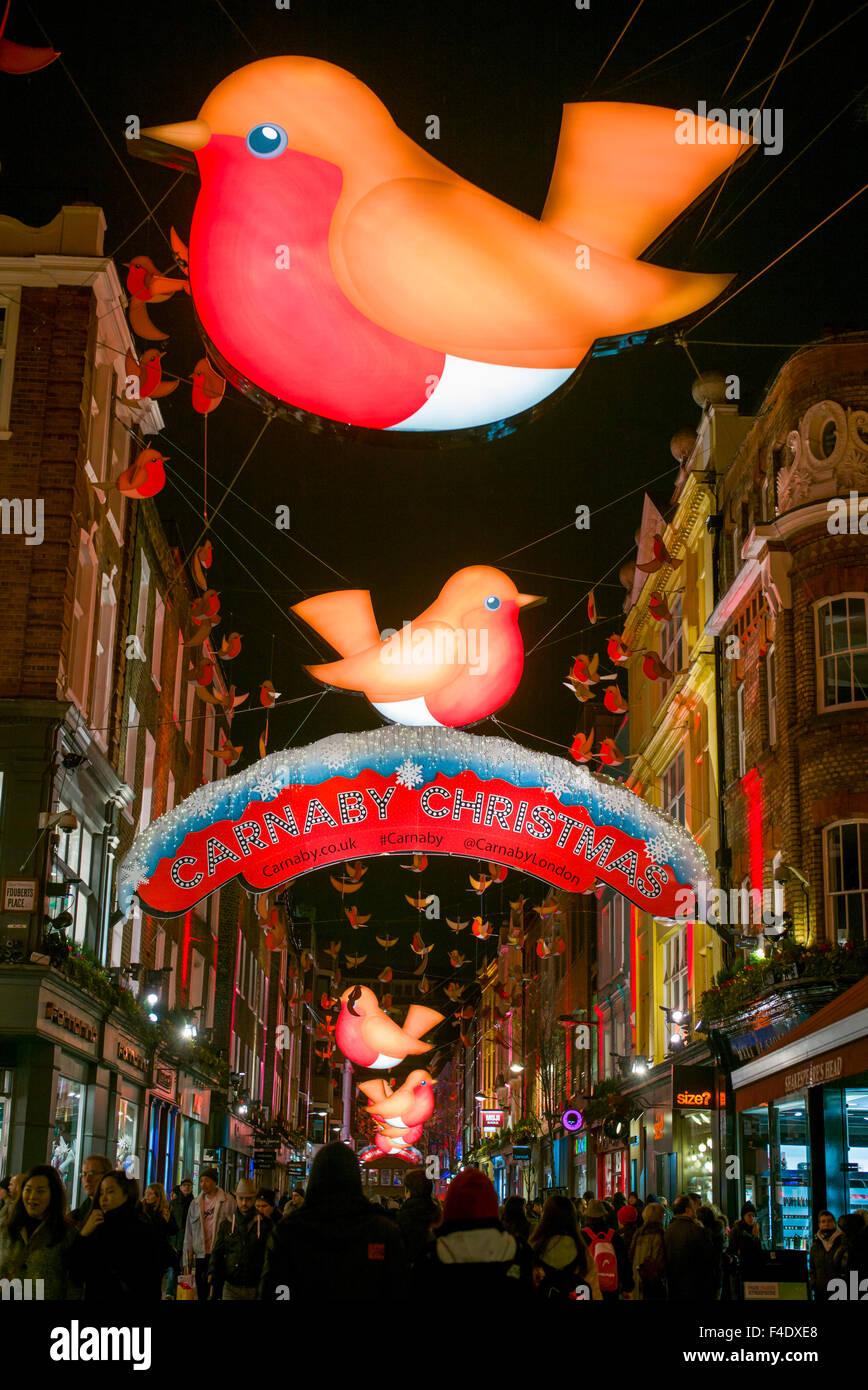 England, London, Soho, Carnaby Street, Christmas signs, evening - Stock Image